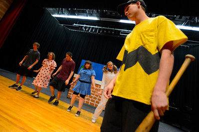 "Florence High School actors Christian Monett, right, Ester Packard, Erin Espinosa, Preston Sandoval, Brianon Burke and Noah Torres rehearse a scene from their upcoming play ""You're a Good Man, Charlie Brown"" Tuesday at the school. Jeff Shane/ Daily Record"