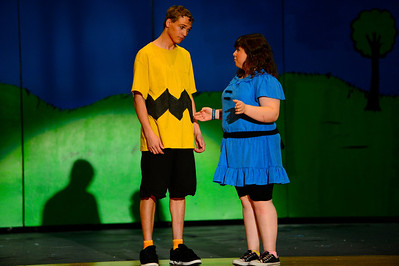 "Florence High School actors Christian Monett, left, and Erin Espinosa rehearse a scene from their upcoming play ""You're a Good Man, Charlie Brown"" Tuesday at the school. Jeff Shane/ Daily Record"