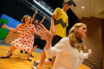 "Florence High School actors Christian Monett, center, Ester Packard, Erin Espinosa, Preston Sandoval, Brianon Burke and Noah Torres rehearse a scene from their upcoming play ""You're a Good Man, Charlie Brown"" Tuesday at the school. Jeff Shane/ Daily Record"