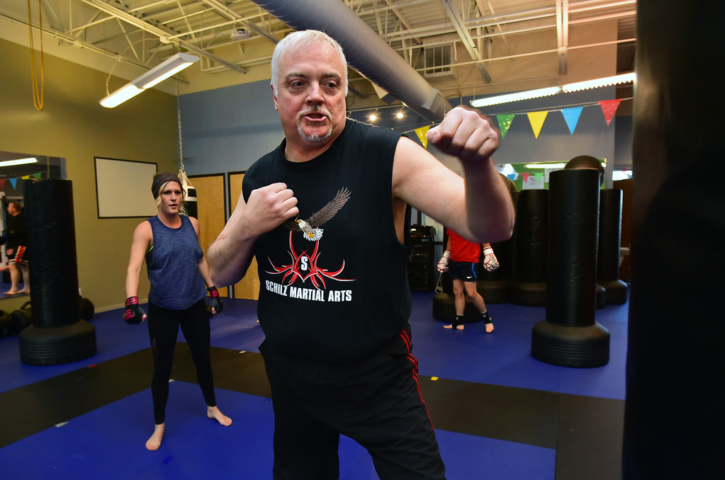. Kru Kevin Schilz calls out a series of techniques in the Adult Cardio Kickboxing class at Schilz Martial Arts in Lafayette on Monday. For more photos go to dailycamera.com Paul Aiken Staff Photographer March 12, 2018.