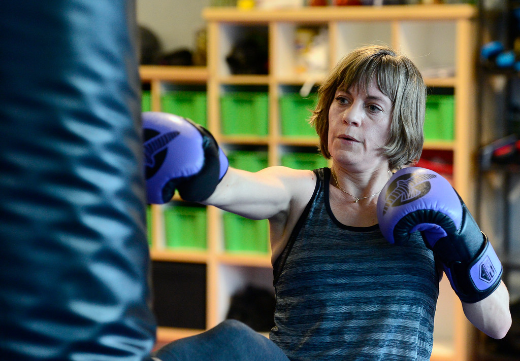 . Theresa Pelser hits a bag in the Adult Cardio Kickboxing class at Schilz Martial Arts in Lafayette on Monday. For more photos go to dailycamera.com Paul Aiken Staff Photographer March 12, 2018.