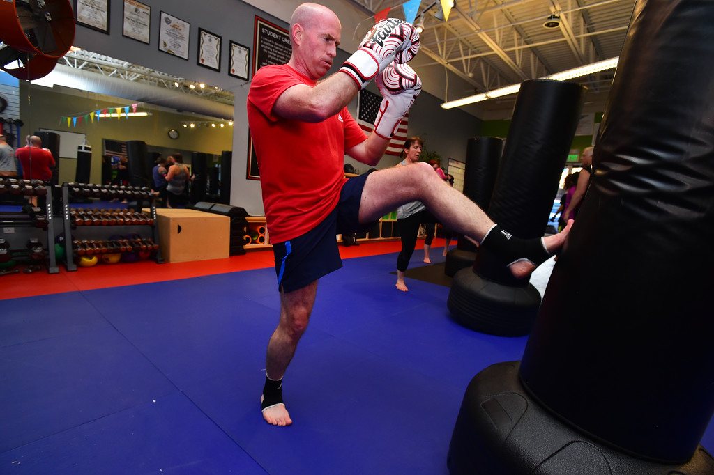 . Bryan Mueller throws a kick in the Adult Cardio Kickboxing at class at Schilz Martial Arts in Lafayette on Monday. For more photos go to dailycamera.com Paul Aiken Staff Photographer March 12, 2018.