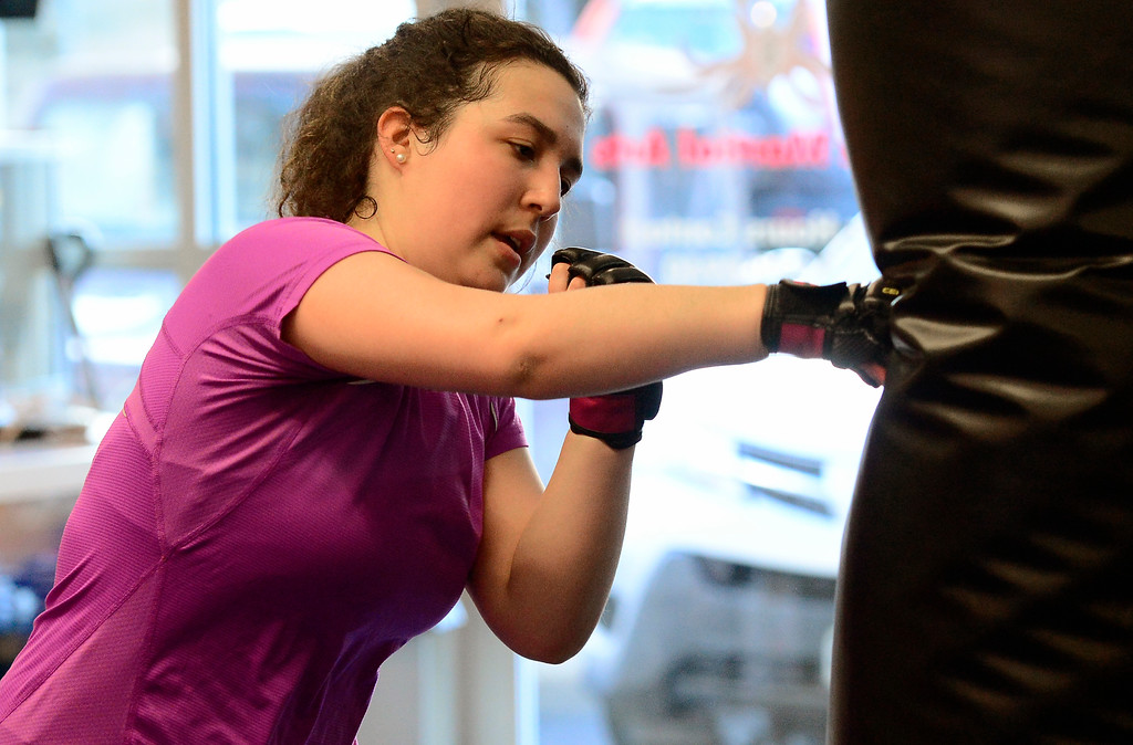 . Maria Jose Urbina hits a bag in the Adult Cardio Kickboxing class at Schilz Martial Arts in Lafayette on Monday. For more photos go to dailycamera.com Paul Aiken Staff Photographer March 12, 2018.