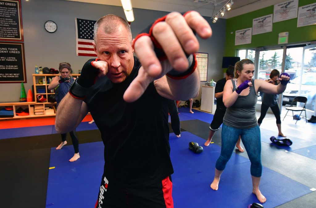 . John Kemp throws combinations in the warm up in the phase of the Adult Cardio Kickboxing class at Schilz Martial Arts in Lafayette on Monday. For more photos go to dailycamera.com Paul Aiken Staff Photographer March 12, 2018.