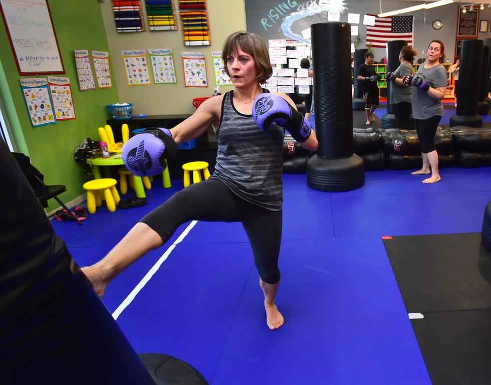 . Theresa Pelser throws kicks in the Adult Cardio Kickboxing class at Schilz Martial Arts in Lafayette on Monday. For more photos go to dailycamera.com Paul Aiken Staff Photographer March 12, 2018.
