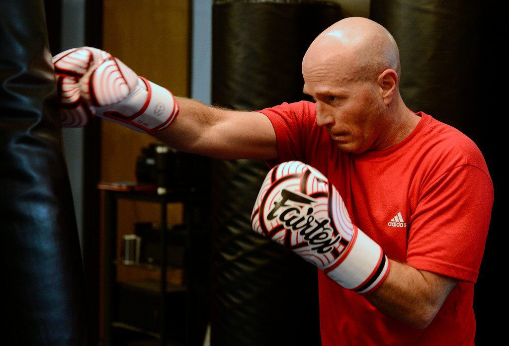. Bryan Mueller strikes a bag in the Adult Cardio Kickboxing class at Schilz Martial Arts in Lafayette on Monday. For more photos go to dailycamera.com Paul Aiken Staff Photographer March 12, 2018.
