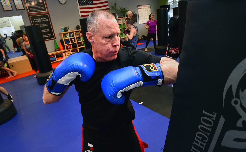 . John Kemp throws elbow strikes in the Adult Cardio Kickboxing class at Schilz Martial Arts in Lafayette on Monday. For more photos go to dailycamera.com Paul Aiken Staff Photographer March 12, 2018.
