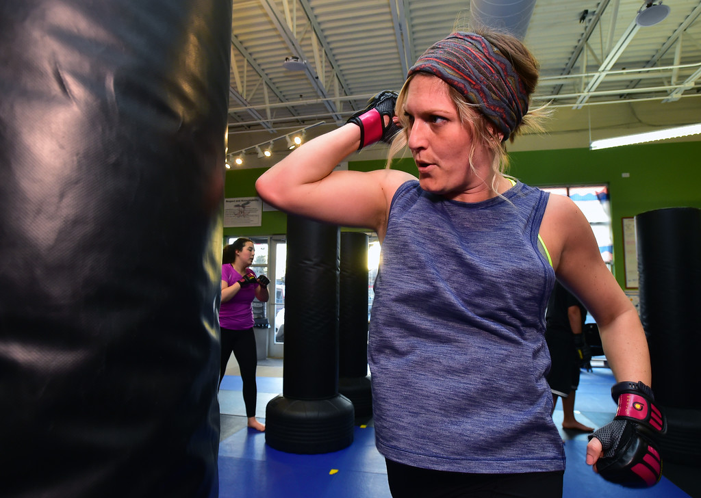 . Christine McKinney throws elbow strikes in the Adult Cardio Kickboxing class at Schilz Martial Arts in Lafayette on Monday. For more photos go to dailycamera.com Paul Aiken Staff Photographer March 12, 2018.