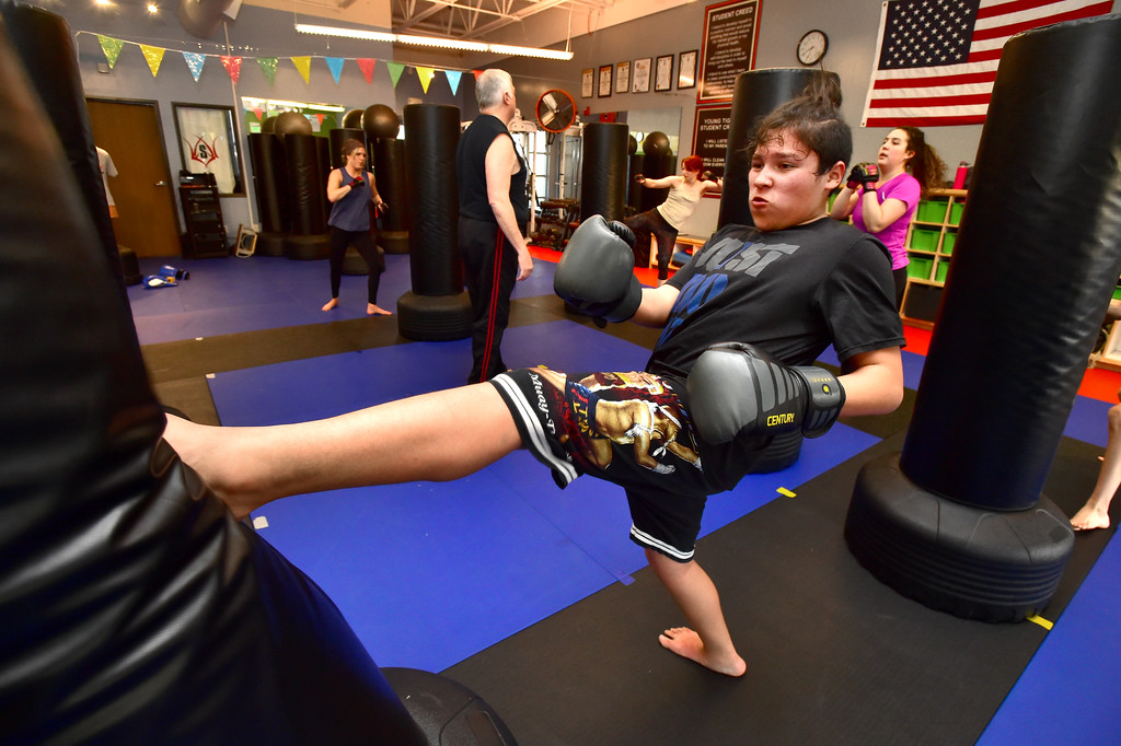 . Eduardo Palafo throws a kick against a bag in the Adult Cardio Kickboxing class at Schilz Martial Arts in Lafayette on Monday. For more photos go to dailycamera.com Paul Aiken Staff Photographer March 12, 2018.