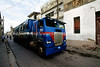CU 997  A truck:bus passes in front of the synagogue