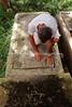 CU 1417  Julito Rodrigues Eli inspects a grave