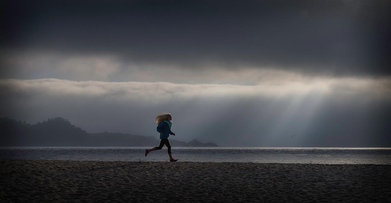 Runner with fog, Carmel River Beach