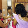 MRS. SHARRON D. RENO, ROSHAUN'S MOTHER GETS PINNED WITH HER COSSAGE JUST BEFORE THE ENTRANCE OF THE BRIDE.