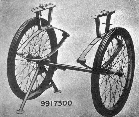 "9917500 – Carrier, Field, Collapsible: <br /> This Carrier was a collapsible 2-wheeled cart designed for carrying one loaded Litter over long distances. It featured two large wire-spoke bicycle wheels with pneumatic tyres size 26 by 2, and also featured a single leaf suspension system. These carts were manufactured exclusively by The Colson Corp, Elyria, Ohio. These Collapsible Field Carriers were often seen at Field Hospital facilities, although photographic evidence exists which suggests that the Carts were used closer to the frontline too. The Carrier's weight was 59 pounds, its width 32 ½ inches, its height 31 inches, and its length 28 inches. When open, the Carrier was held in upright position by a hinged tubular, metal inverted V-shaped stand, which could be folded when not in use. This version replaced the old Wheeled Litter Carrier, with wooden spoke solid rubber tyres, buggy type, and higher weight (72 pounds).<br /> <br />  <a href=""http://med-dept.com/litters.php"">http://med-dept.com/litters.php</a>"