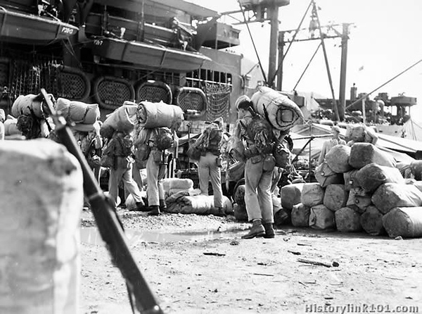 "AB-33 Marines go up the cargo net of a Navy transport prior to the movements of a number of Leathernecks to a new fighting front. Samoa - October 1942<br /> <br />  <a href=""http://www.historylink101.com/wwII_b-w/marines/samoatroops/index.html"">http://www.historylink101.com/wwII_b-w/marines/samoatroops/index.html</a>"