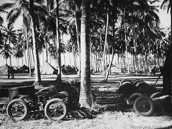 COMMUNICATION TRAILERS used by Marines to haul equipment to and from combat areas are shown lined up ready for use at a moments notice. Two men pulling in front can move the trailers but rough terrain and a heavy load usually requires a couple of men pushing from the rear. Guadalcanal - August 1943