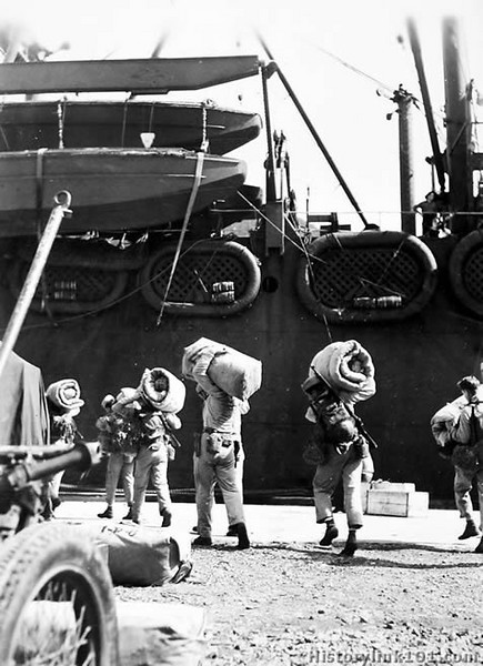 "Loaded to the gills: US Marines make ready to board a waiting transport which will carry them to a fighting front. Samoa - October 1942<br /> <br />  <a href=""http://www.historylink101.com/wwII_b-w/marines/samoatroops/index.html"">http://www.historylink101.com/wwII_b-w/marines/samoatroops/index.html</a>"