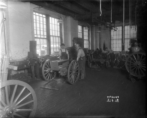 Title:  Workers Assemble Gun Carts at McCormick Works <br /> <br /> Description:  Factory workers assembling artillery carts for the United States military during World War I at International Harvester's McCormick Works.<br /> <br /> Wisconsin Historical Images. Image ID:  9192 <br /> <br /> May 6, 1918