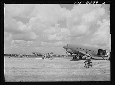 TITLE:  Fort Bragg, North Carolina. Airborne bicyclists and motorcycles taking over an airfield in a military demonstration<br /> <br /> <br /> <br />   LC-USW3- 008399-D