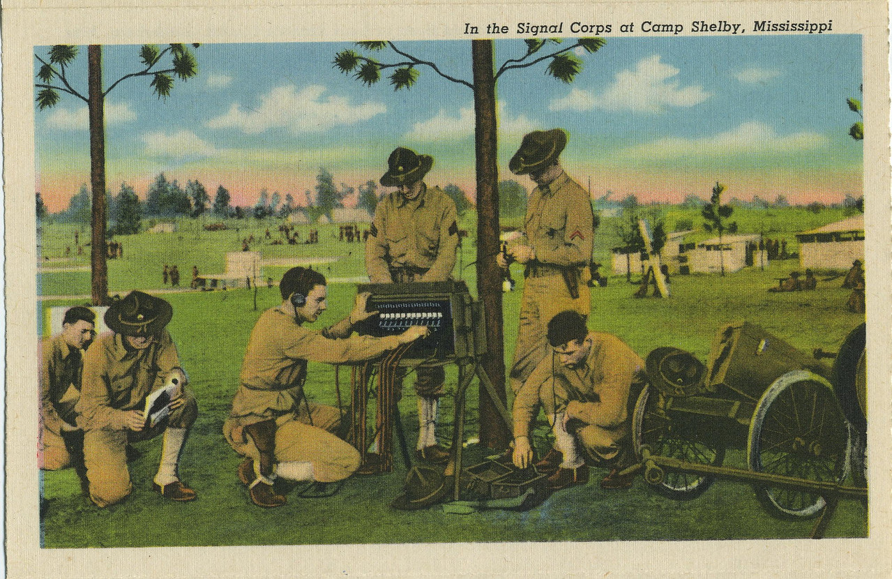 RL-16 CARTS (THINK ONE HAS HAD ITS WIRE BRACKET REMOVED)<br /> <br /> GREETINGS FROM HATTIESBURG MISSIPPI<br /> <br /> POSTCARD FOLDOUT BOOKLET<br /> <br /> SIGNAL CORPS AT CAMP SHELBY<br /> <br /> SCANNED FROM POSTCARD<br /> <br /> (CRAIG JOHNSON COLLECTION)