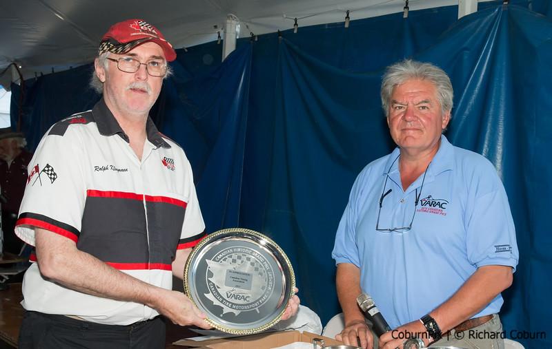 Ralph Klingmann accepts plaque