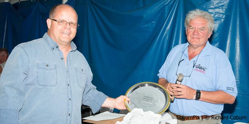 Jeff Hoskin accepts plaque