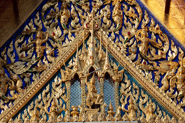 A Deity with Sword (Represents Indra God) in the Five-Pinnacle Castle on the Pediment of Phra Ubosot, Wat Arun Ratchawararam