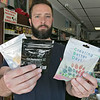 General Manager Sean McGonagle of Lineage Vapors/Twin City Emporium shows off some of the CBD products they used to sell. Those items have quickly dwindled given the state policy that came out in June banning the sale of edible CBD products for people and pets. He is holding some of the last of the CBD edible products from Fresh Leaf and Creating Better Days that they have left in the store. SENTINEL & ENTERPRISE/JOHN LOVE