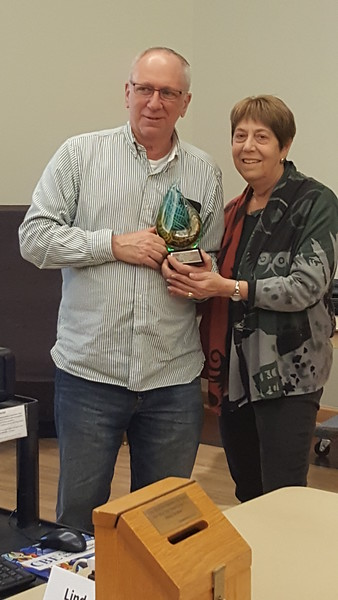 Marty Z gives award to Janet P upon retirement