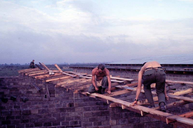 WORKING ON A ROOF. KEITH MCGRAW(NAILING) RICK ZEHNER, MIKE MEQUET (BG)