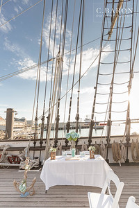 Same-sex wedding on the 1877 Tall Ship The Elissa in Galveston, Texas with a gorgeous summer sunset.