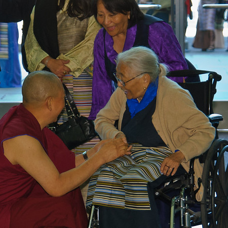 Monk greets an elderly lady