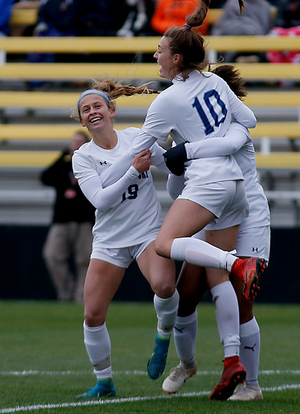 Cincinnati Country Day's Kate Brock (10) reacts with her teammates after her second goal against Kirtland during their Division III Championship soccer game at MAPFRE Stadium in Columbus Friday, Nov. 9, 2018.