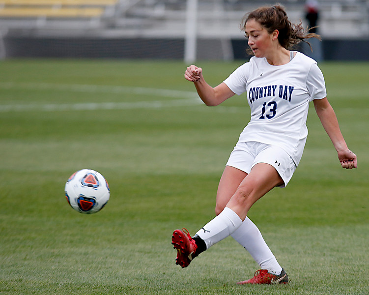 Cincinnati Country Day defender Janie Reiring boots a pass against Kirtland during their Division III Championship soccer game at MAPFRE Stadium in Columbus Friday, Nov. 9, 2018.