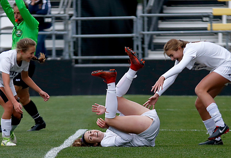 Cincinnati Country Day forward Kate Brock (center) reacts after scoring her secong goal, the teams third, against Kirtland in their Division III Championship soccer game at MAPFRE Stadium in Columbus Friday, Nov. 9, 2018.