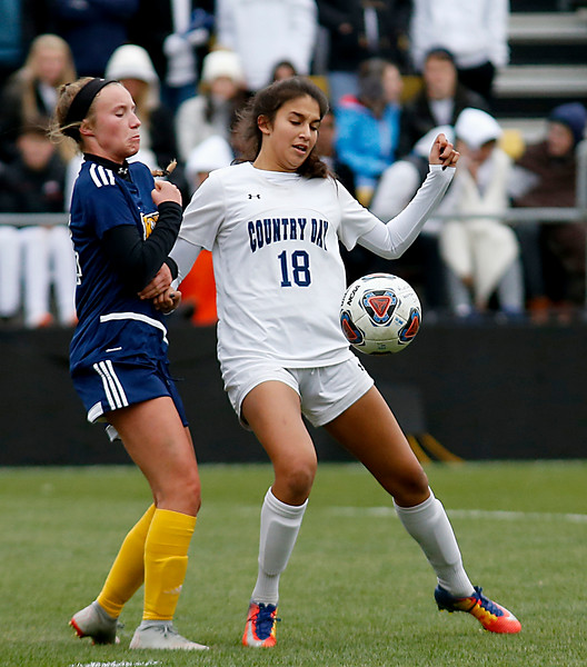 Cincinnati Country Day defender Emily Ram makes a stop in front of Kirtland defender Gabby Piazza during their Division III Championship soccer game at MAPFRE Stadium in Columbus Friday, Nov. 9, 2018.