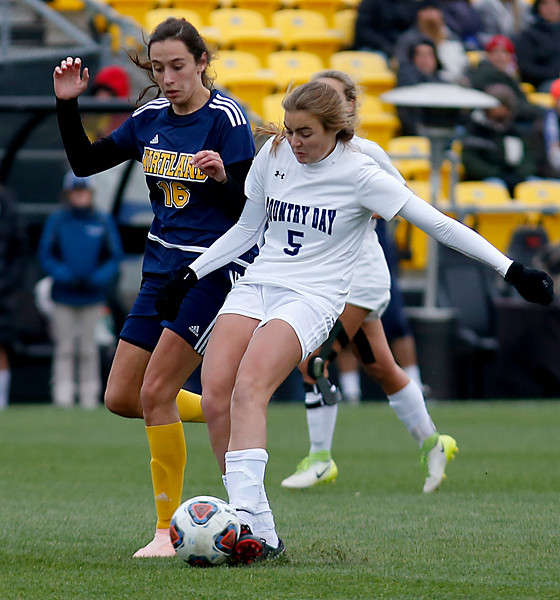 Cincinnati Country Day forward Lawson Renie shoots while covered by Kirtland midfielder Regan Ramirez during their Division III Championship soccer game at MAPFRE Stadium in Columbus Friday, Nov. 9, 2018.