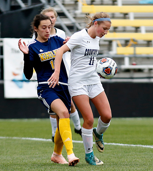 Cincinnati Country Day forward Jenna Setters takes a pass in front of Kirtland midfielder Lidia Rodin during their Division III Championship soccer game at MAPFRE Stadium in Columbus Friday, Nov. 9, 2018.