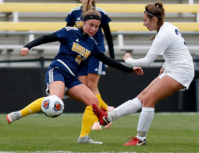 Cincinnati Country Day midfielder Chloe Webb passes against Kirtland defender Gabby Piazza during their Division III Championship soccer game at MAPFRE Stadium in Columbus Friday, Nov. 9, 2018.
