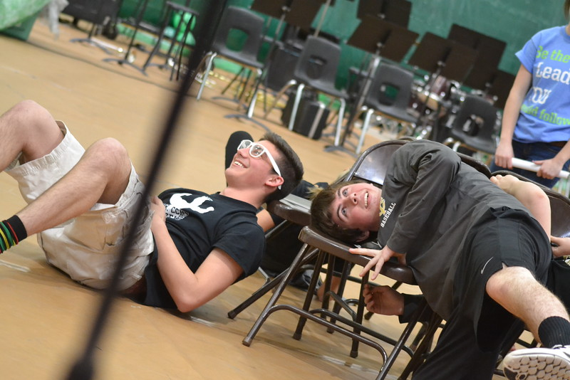 Canon City High School students DAkota Bolton and Zach Mitchell take part in a lively game of musical chairs during an assembly Friday in the Tiger Dome. Carie Canterbury/Daily Record 3-4-16