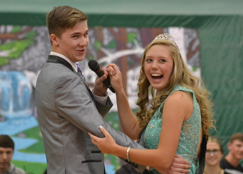 Canon City High School senior Lucas Strickler serenades Erica Stoner, the 2016 Springfest Queem, during an assembly Friday in the Tiger Dome. Carie Canterbury/Daily Record 3-4-16