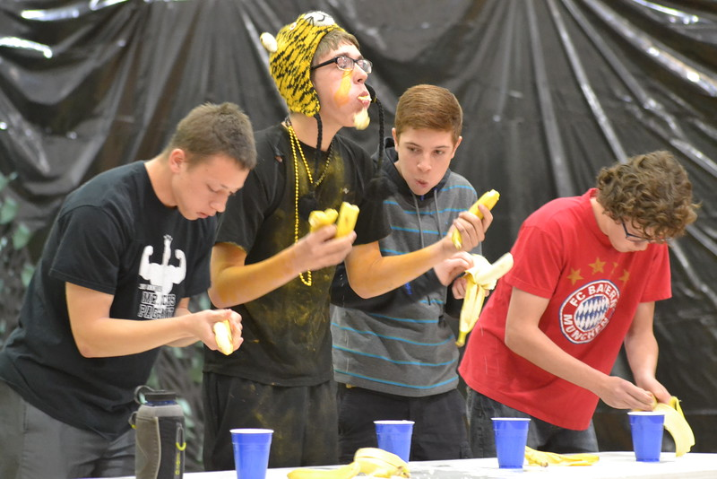 Canon City High School students take part in a banana eating contest during an assembly Friday in the Tiger Dome. Carie Canterbury/Daily Record 3-4-16