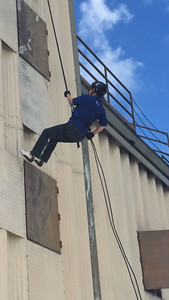 Clear Springs Assistant Principal Lori Diaz rappels with JROTC