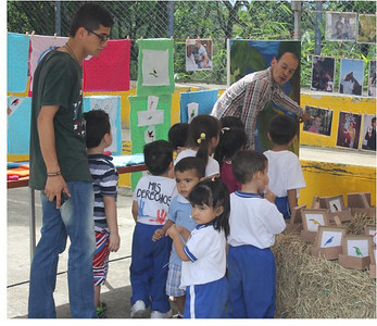 Young community leaders teaching children about bird diversity