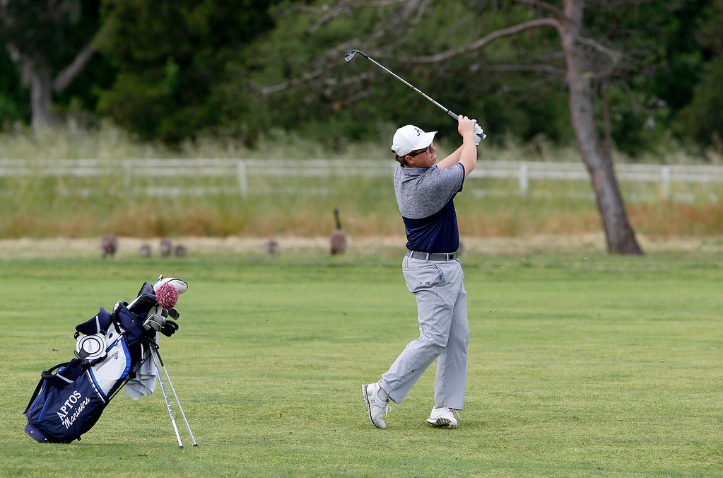 . Max Meltzer from Aptos High hits his approach shot on the fifteenth-hole at Laguna Seca Golf Ranch during the CCS Golf Championships on Tuesday, May 16, 2017.   (Vern Fisher - Monterey Herald)