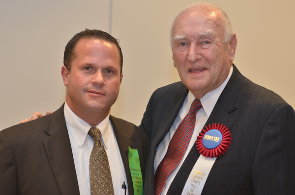 Former Johnstown Jets goalie Ed Johnston (right) poses with Cambria County Commissioner Tom Chernisky.