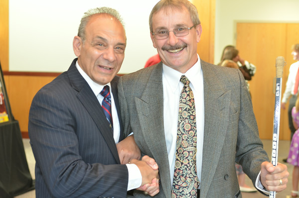Pitt-Johnstown wrestling coach Pat Pecora (left) poses with Bob Manculich.