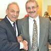 Pitt-Johnstown wrestling coach Pat Pecora (left) poses with Bob Manculich.