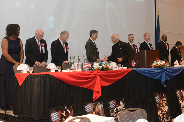 The Cambria County Sports Hall of Fame inductees take the stage along with Rev. Francis Balestino, who gave the opening invocation.