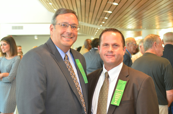 Tribune-Democrat sports reporter Mike Mastovich (left) poses with Cambria County Commissioner Tom Chernisky.